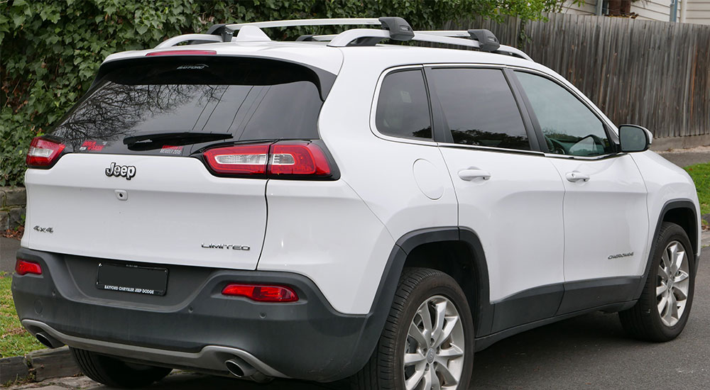 White Jeep Cherokee Limited with tinted windows in Ocala, Florida.