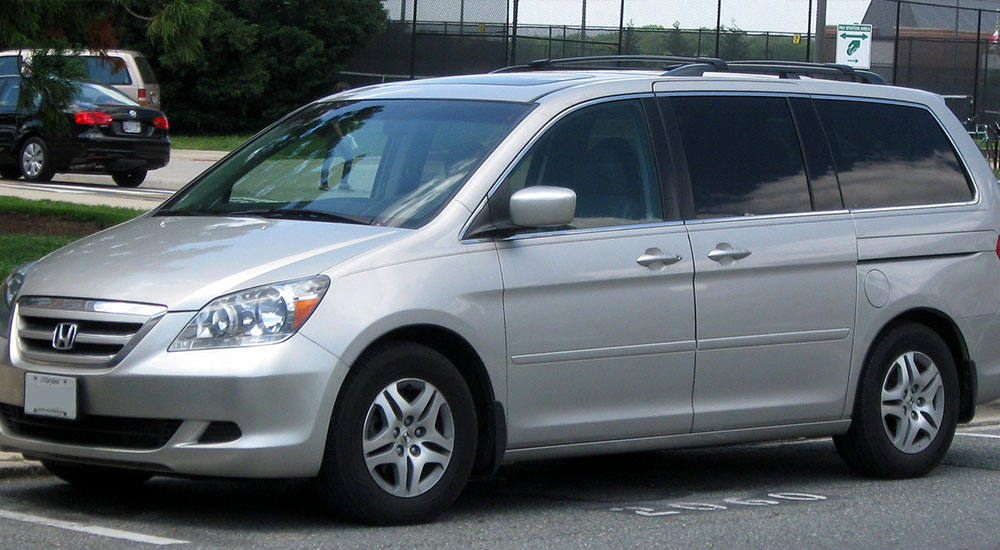 A gray Honday Odyssey minivan with tinted windows in Ocala, Florida.