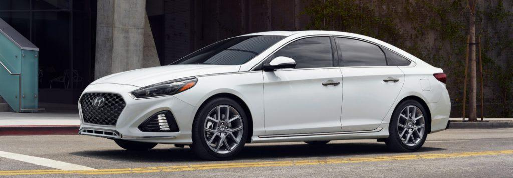 A white Hyundai Sonata with tinted windows in Ocala, Florida.