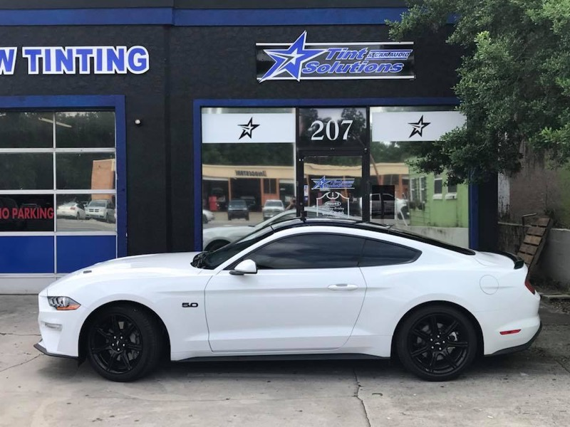 White Ford Mustang 5.0L V8 with tinted windows in Ocala, Florida.